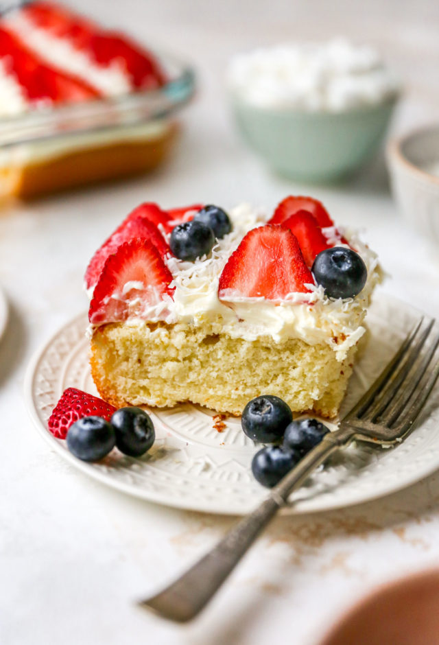 slice of flag cake with whipped topping and strawberries