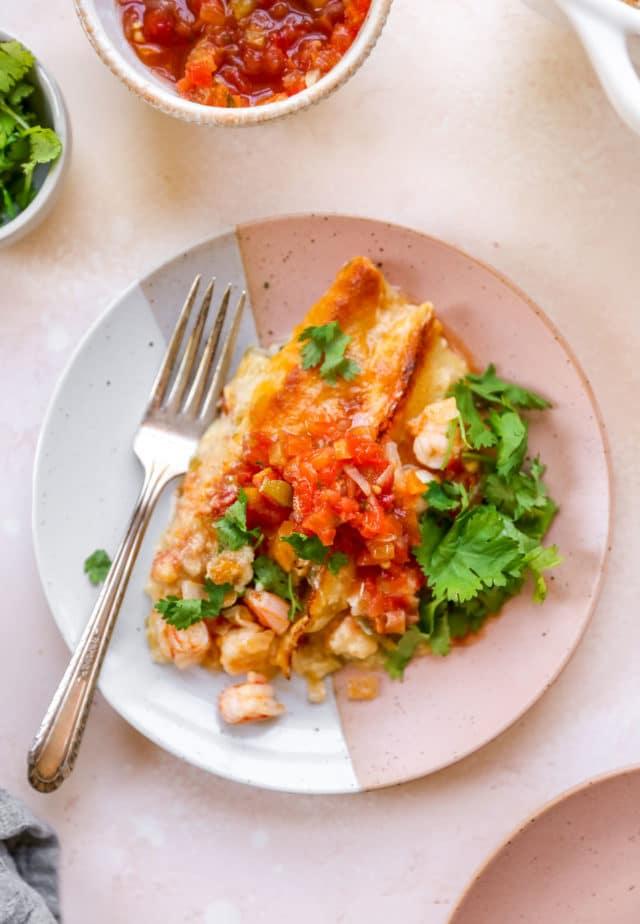 shrimp enchiladas topped with fresh cilantro and salsa