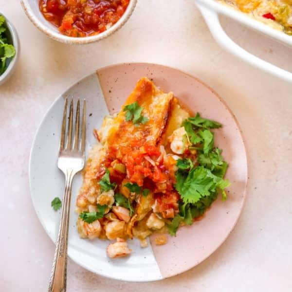shrimp enchiladas served with salsa and fresh cilantro