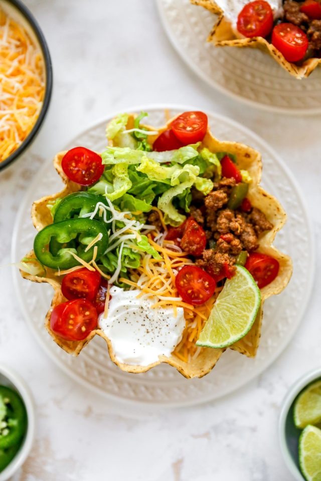 making a tostados recipe with taco toppings