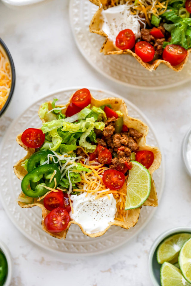 tostados topped with ground beef, tomatoes, cheese and sour cream