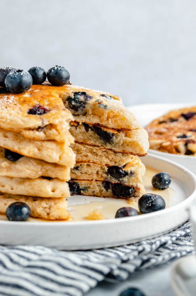 stack of blueberry pancakes with a bite cut out