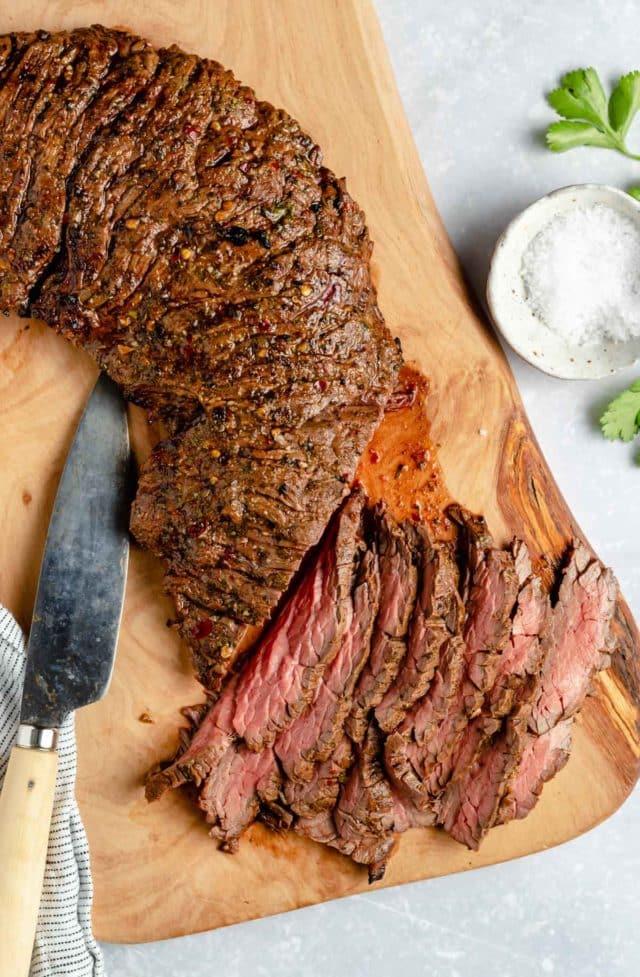 sliced beef on a cutting board