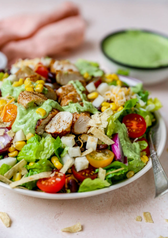 southwest salad topped with a creamy avocado dressing