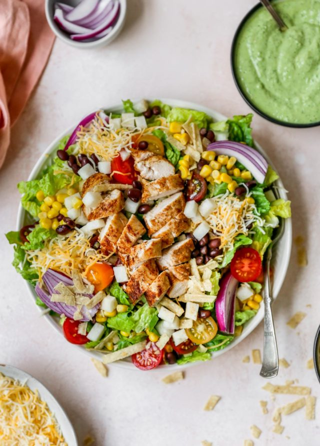 southwest salad topped with chicken, cheese and tortilla strips