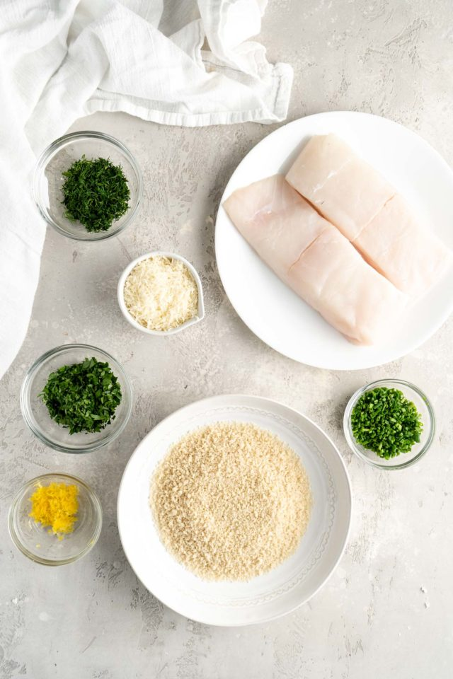 halibut fillets and seasonings in small white bowls