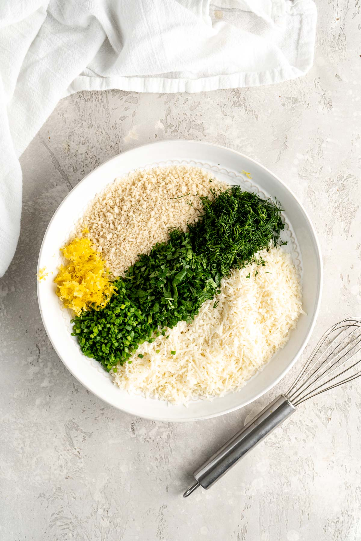 fresh herbs and panko bread crumbs in a white bowl