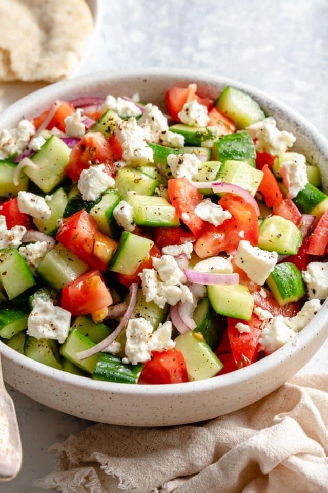 chopped veggie salad in a white bowl