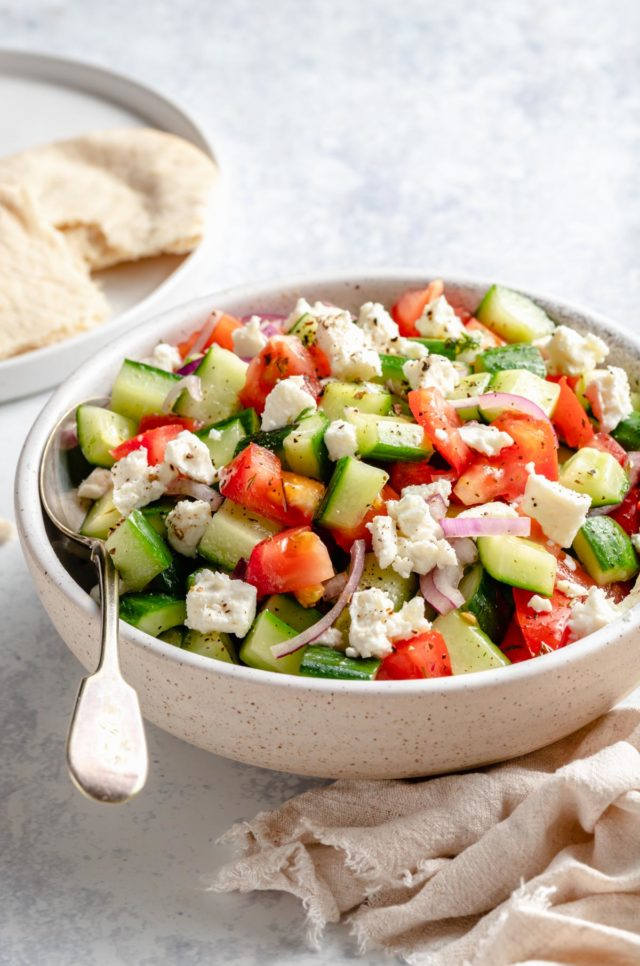 salad made with chopped cucumber, tomato and sliced red onion