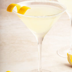lemon drop martini garnished with a twist of lemon peel