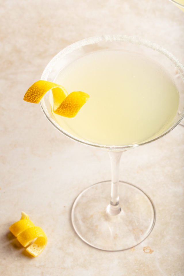lemon drop cocktail with a lemon peel twist for garnish