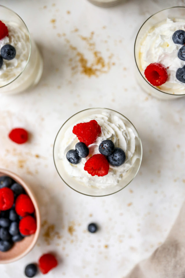 cheesecake cups topped with raspberries and blueberries