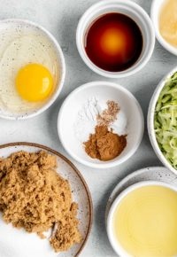 small bowls of ingredients for zucchini muffins