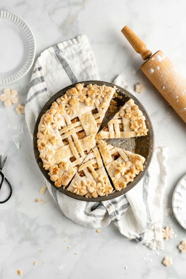 apple pie in a pie dish cut into servings