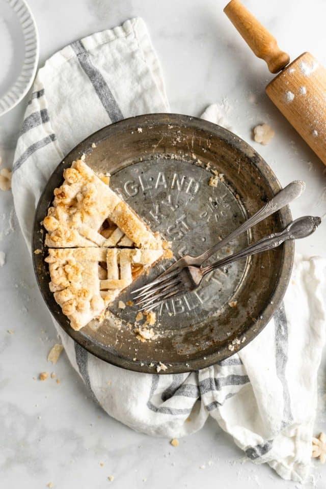 2 slices of apple pie left in a pie dish