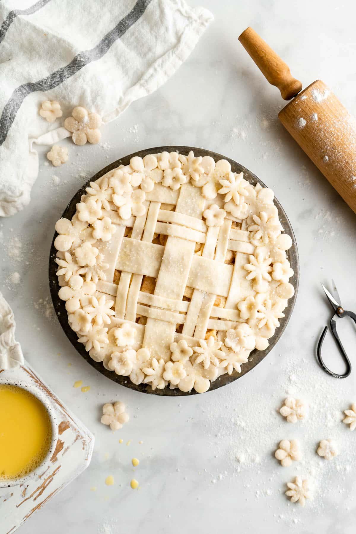 adding top crust of homemade apple pie