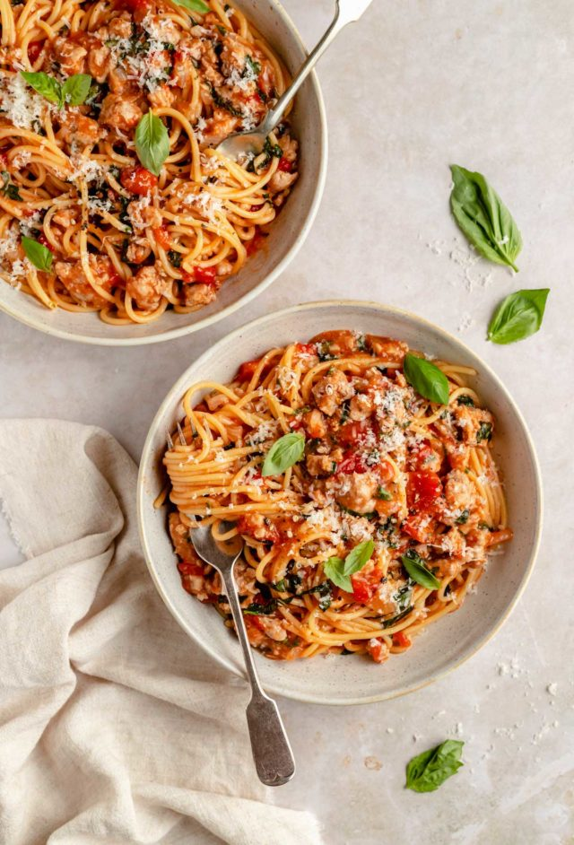 two bowls filled with pasta with sausage and fire roasted tomatoes