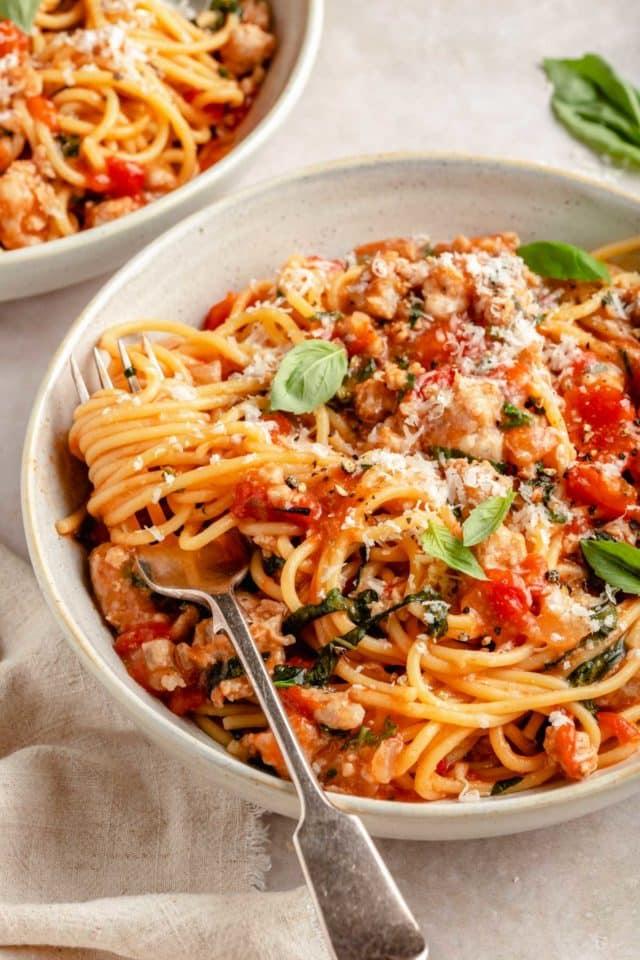 sausage pasta twirled around a fork