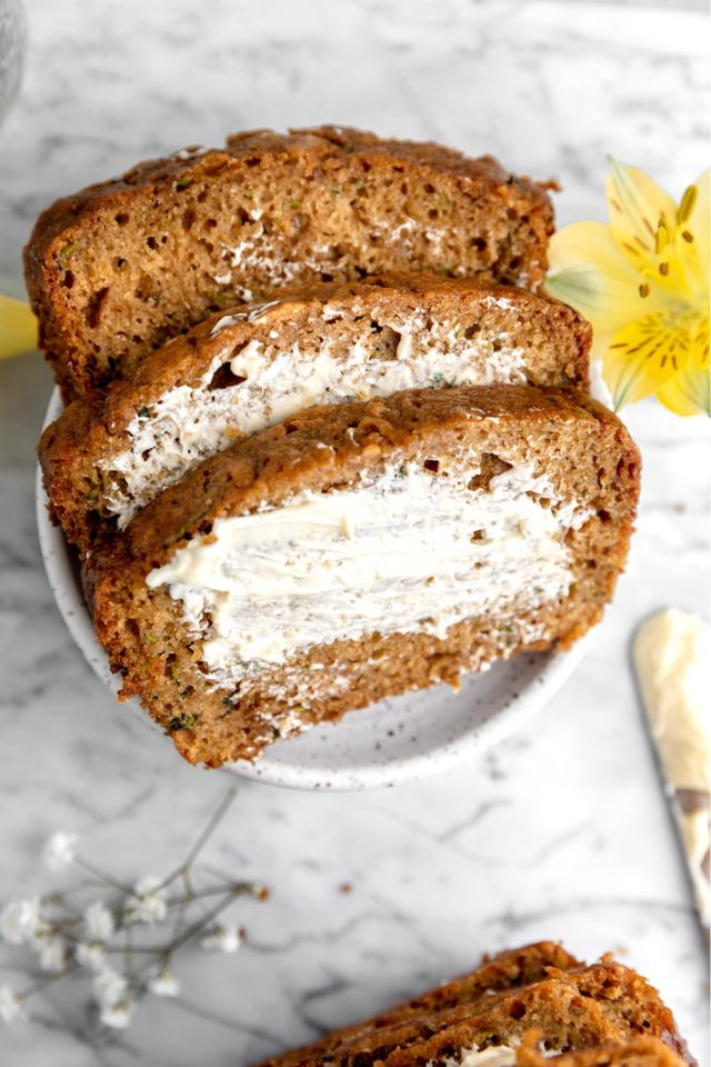 slices of bread with butter spread over the top