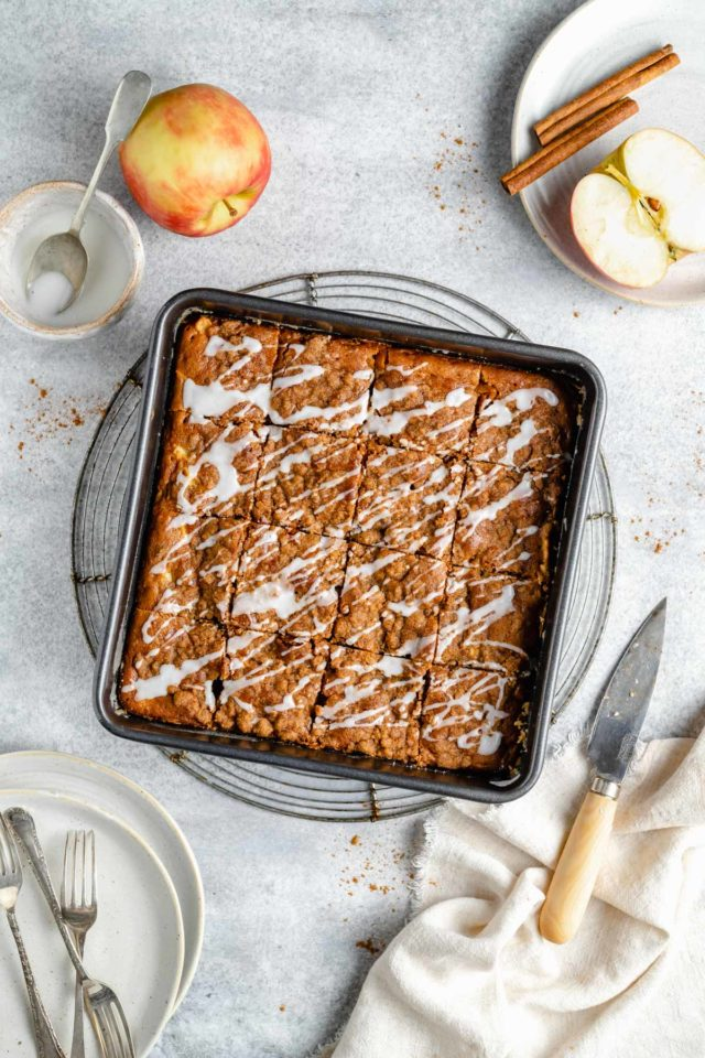 apple coffee cake with a glaze drizzled over the top