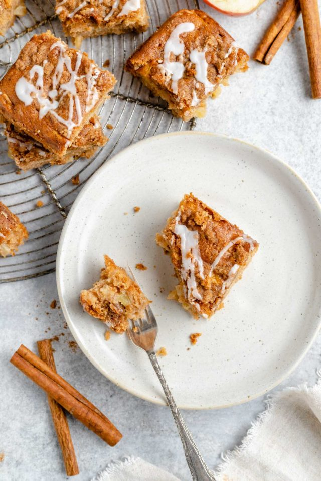 piece of apple coffee cake on a small white plate