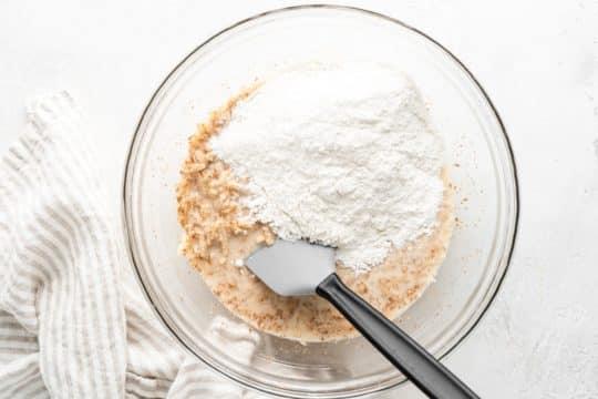 stirring flour into wet batter ingredients