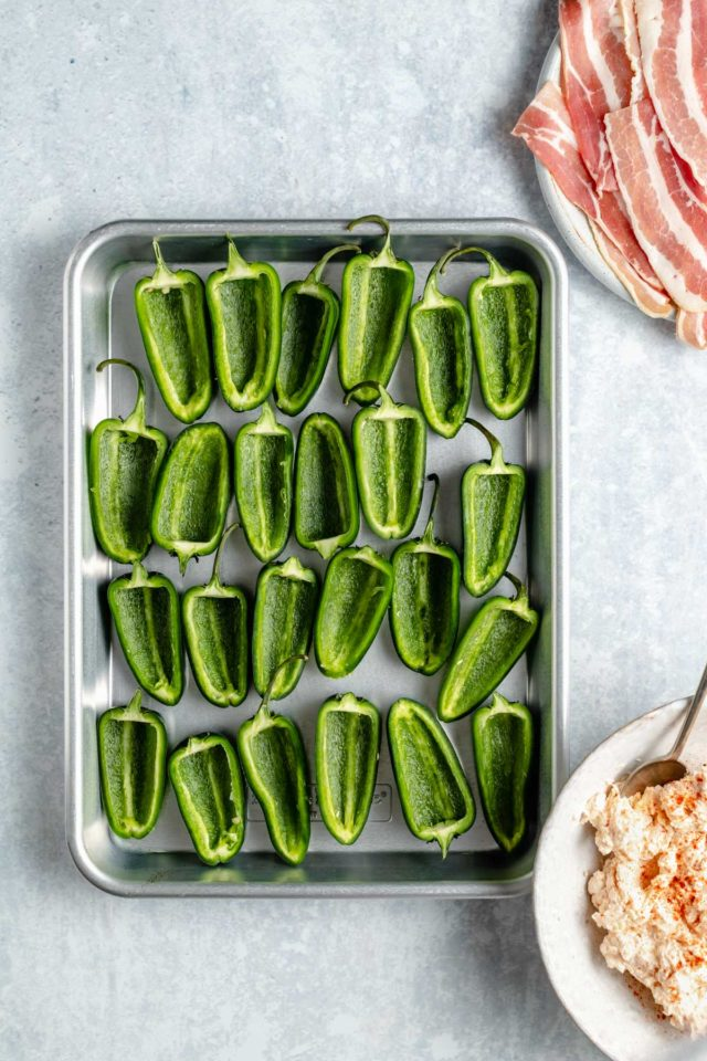 sliced jalapeno peppers on a baking sheet
