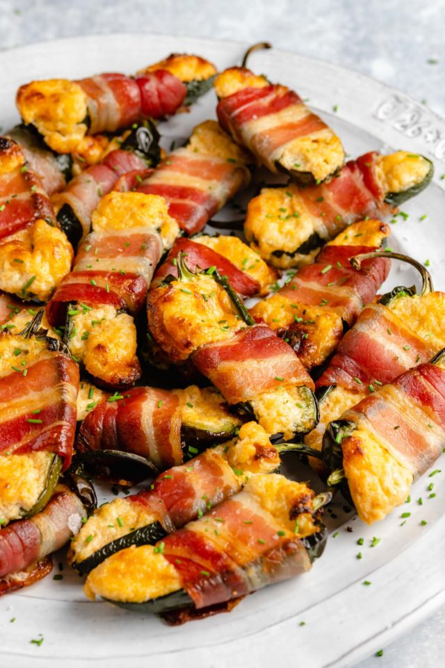 jalapeno peppers stuffed with cheese and wrapped with bacon