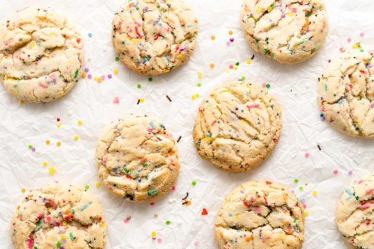 funfetti cookies on parchment lined baking pan
