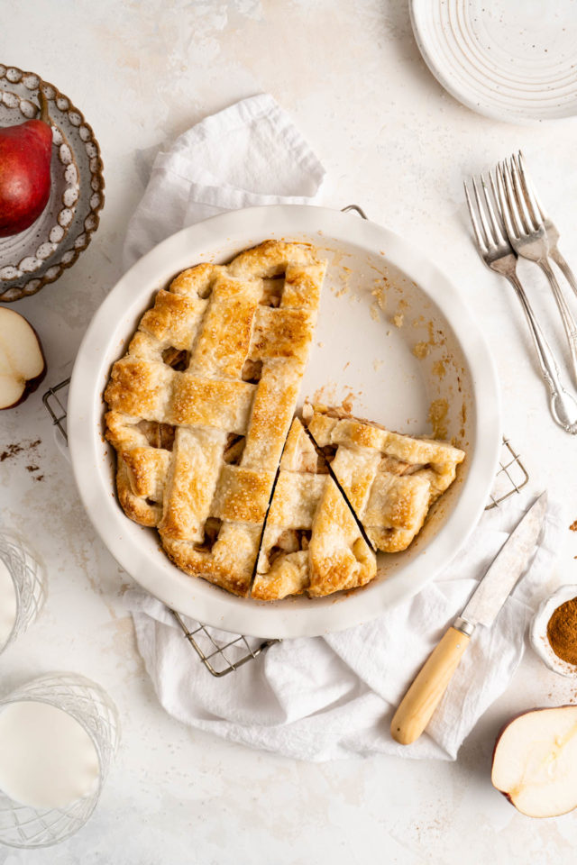 slices of homemade pear pie in a pie dish