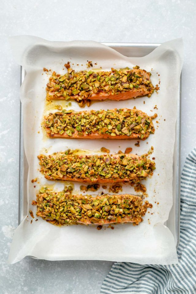 salmon fillets on a baking sheet lined with parchment paper