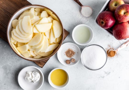 ingredients for apple crumb pie measured into small bowls