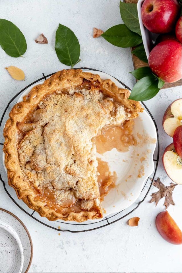 apple crumb pie with a slice removed