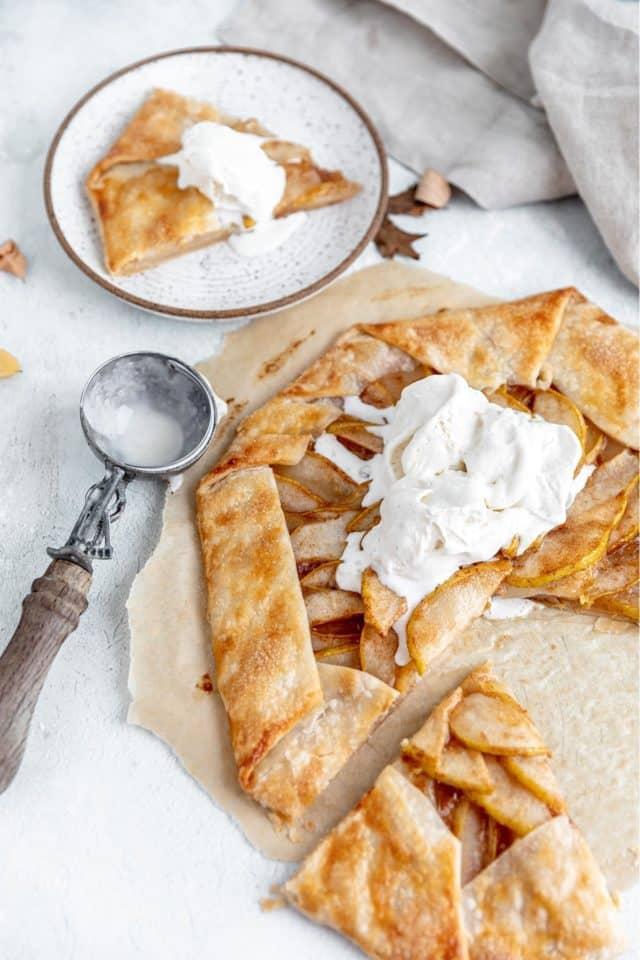 vanilla ice cream melting over a pear galette
