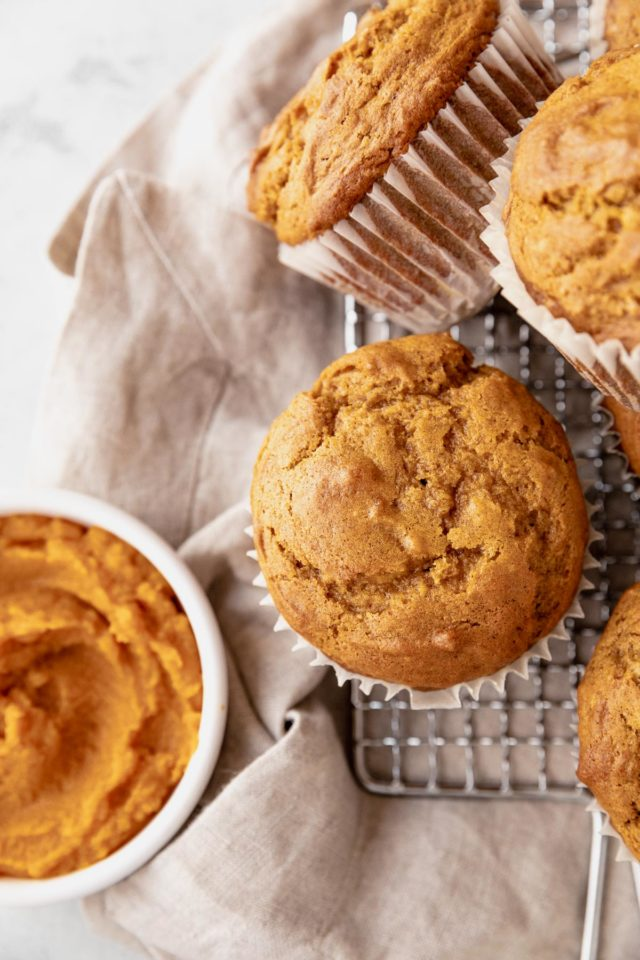 baked pumpkin muffins on a wire cooling rack