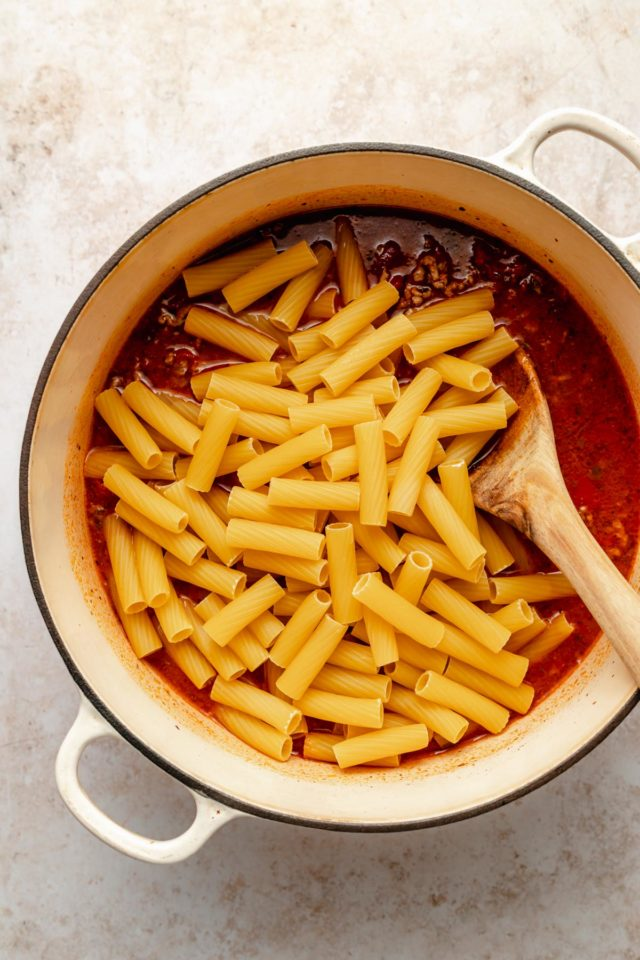 stirring pasta in with marinara and ground beef