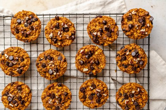 pumpkin oatmeal muffins on a wire rack to cool