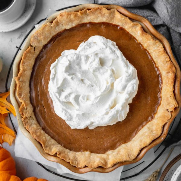 best pumpkin pie in a flaky crust and topped with whipped cream